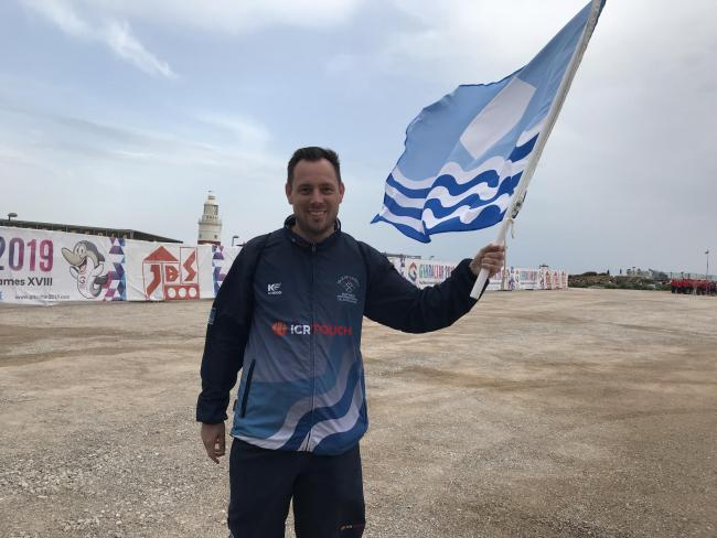 Team Isle of Wight table tennis player Dan Burns with the Isle of Wight flag in Gibraltar.  Photo: Matt White