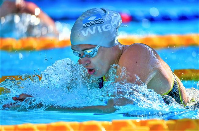 Team Isle of Wight swimmer Abi Lacey, who earned a new personal best time to win silver in the 100m individual medley at the Island Games in Gibraltar yesterday (Thursday).