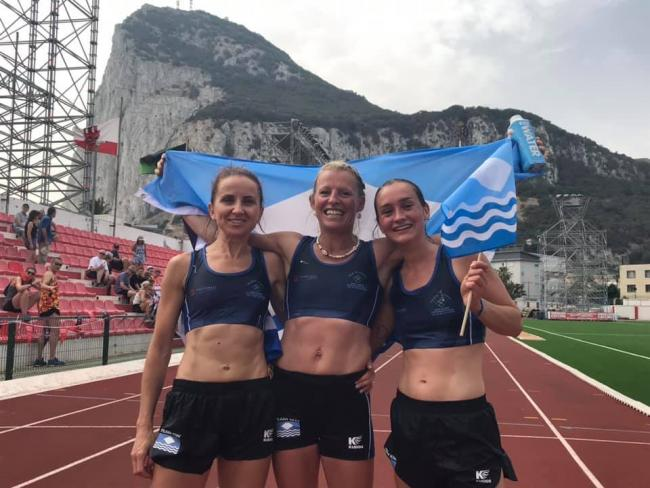 Laura Brackley, Charlie Metcalfe and Rosie Sexton won silver for Team Isle of Wight in the women's half marathon in the heat of Gibraltar.