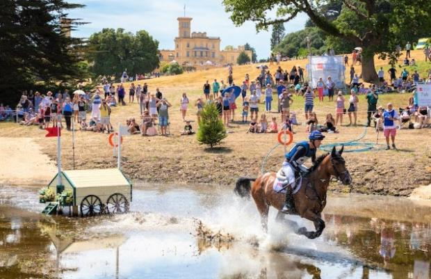 Isle of Wight County Press: Some of the cross-country riding at last year's Osborne Horse Trials. Photo: BEDE Events