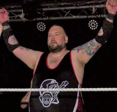 Isle of Wight County Press: Man mountain Maxx Carnage celebrates claiming the Outcast Pro Wrestling Isle of Wight Championship belt on Saturday.