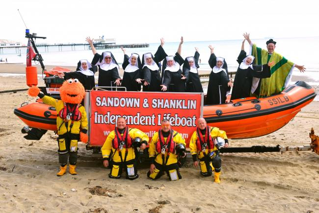 Sandown. Savoyards Sister Act cast on board a Sandown and Shanklin Independent Lifeboat. Front left, Monster, Chris Bartlett, Mark Birch, and Richard Burns. Back left, Sarak Jukes, Kim Ball, Rebecca Finch, Madeleine Holmes, Rachael Rogers, Charlotte Rosco