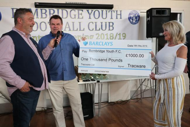 From left, Glen Walker, chairman of Bembridge Youth Football Club, Andy Maley and Debbie Maley, directors of Tracware.
