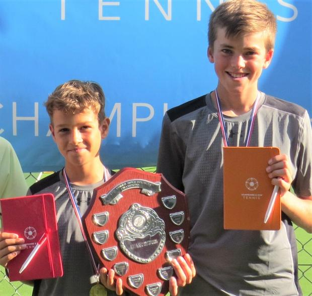 Isle of Wight County Press: Arthur Attrill, right, with his doubles partner, Dennis Dimov after they won the Hampshire and IW County Championship U12s doubles title in Winchester. Arthur beat Dennis in the final of the singles competition too. Photo: Hampshire and IW Lawn Tennis Association.