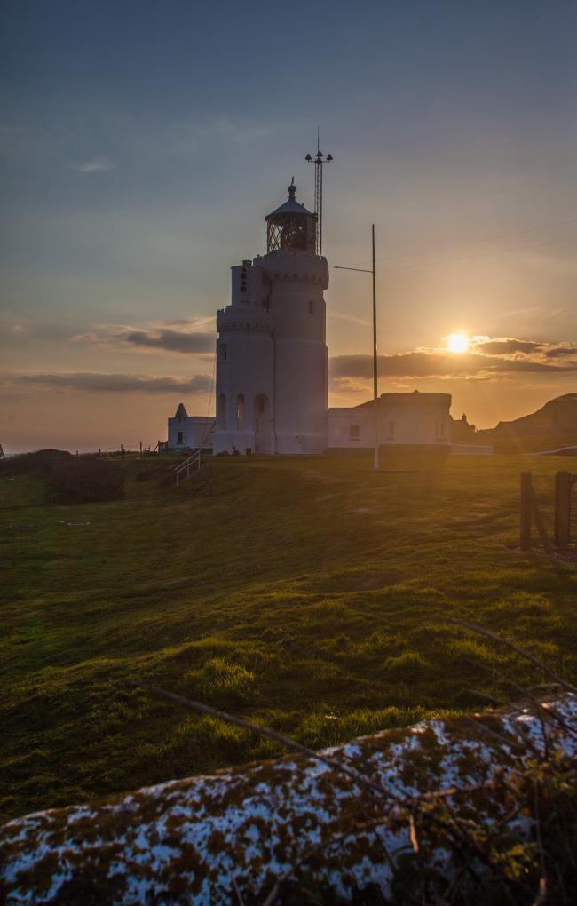 Weather picture. St Catherines Lighthouse, Niton, at sunset..