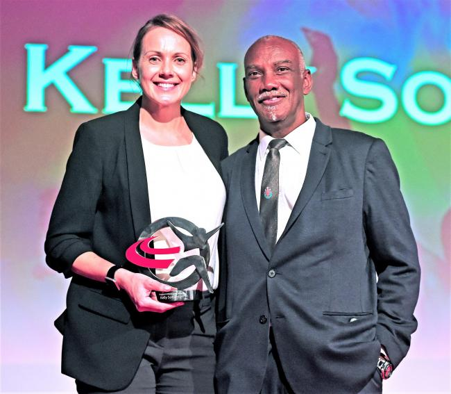 Isle of Wight-born athlete, Kelly Sotherton, receiving an award from to mark her induction into the 2019 England Athletics Hall of Fame from Aston Moore, a coach who competed for GB at triple jump.