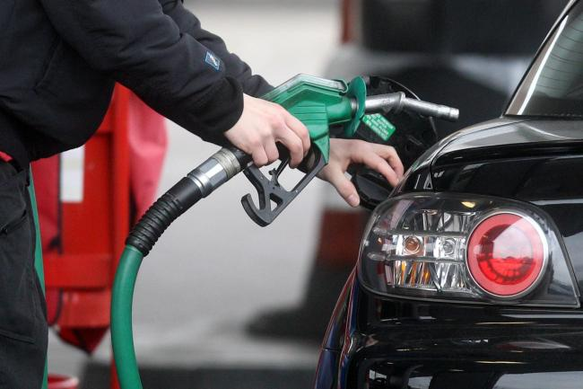 A driver fills up with unleaded petrol