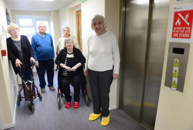 Some of the residents who feel like prisoners trapped on the top floor because of the broken lift; from left Margaret Whitewood, James and Elizabeth Rowell, Diana Round and Patricia Smith next to the broken.