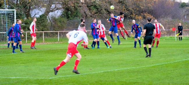 East Cowes Vics (in red and white) in action against United Services Portsmouth this afternoon.  Photo: Robin Crossley