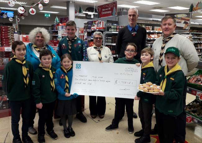 Members of the Scout group receiving the cheque