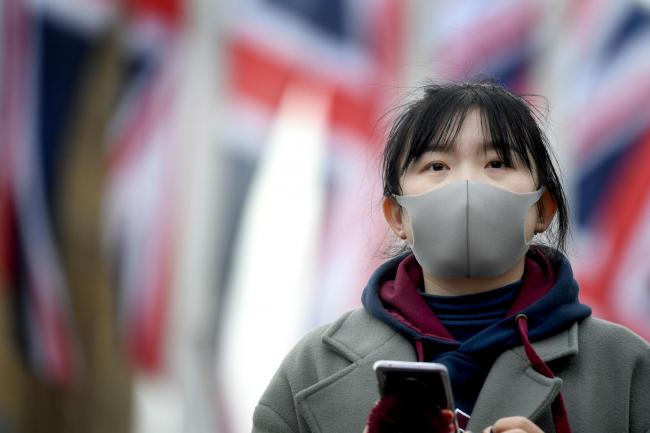 A woman wears a face mask in Parliament Square, London. Picture by Kirsty O'Connor/PA Wire.