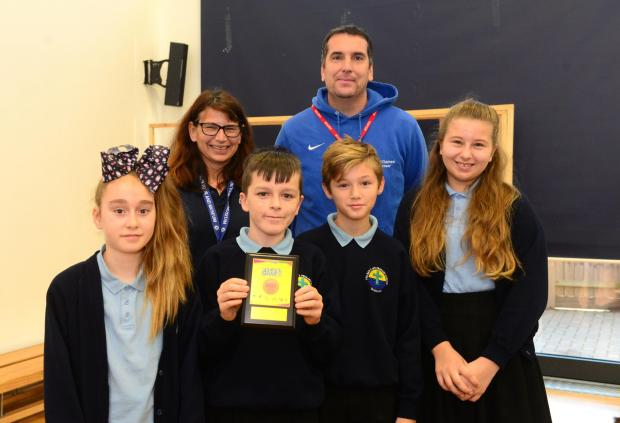 Isle of Wight County Press: Sports games organiser, Andy Day, with a group of students of The Bay CE Primary School last year. FILE