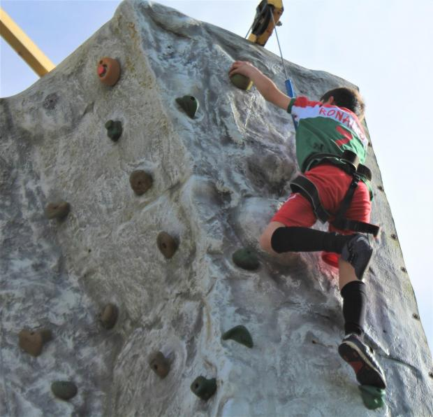 Isle of Wight County Press: Mohammed Al Ashkar, aged nine, stretches for the top of the wall.