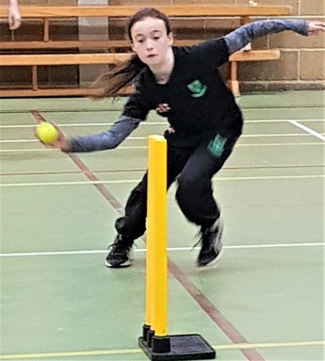 Isle of Wight youngster, Lily Millwood, fielding.