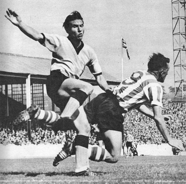 Roy Shiner, right, in the thick of the action for Sheffield Wednesday against Wolverhampton Wanderers at Molineux, in 1957.
