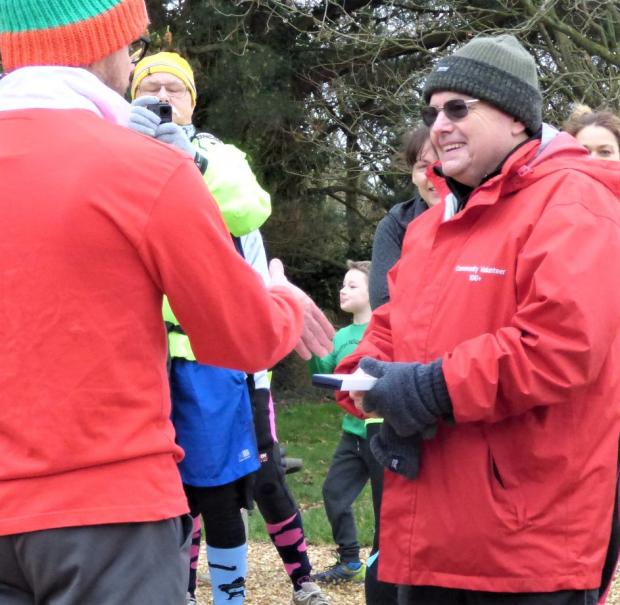 Isle of Wight County Press: Ray receiving an accolade to mark the 400th Medina parkrun.