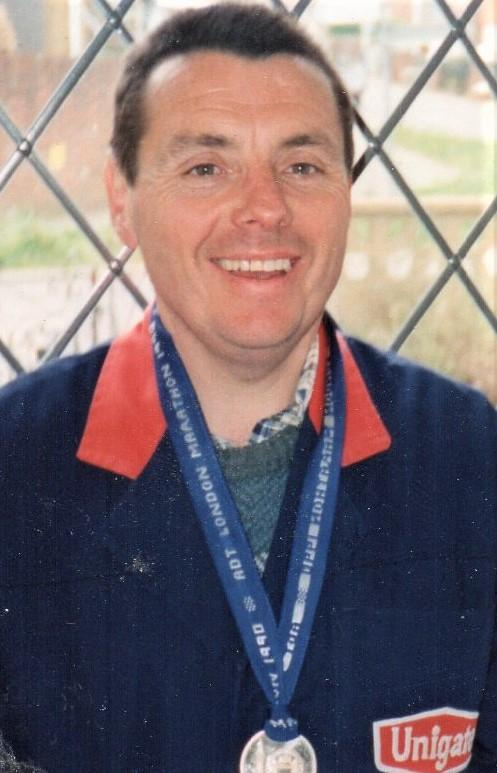 Isle of Wight County Press: Ray Scovell with his medal after completing the 1990 London Marathon.