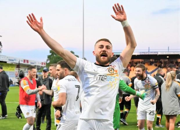 Isle of Wight County Press: Dan Butler celebrating making the play-off final for Newport County last season.