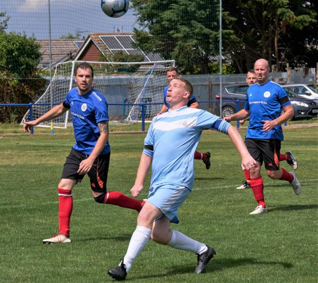 Isle of Wight NHS Spartans (pale blue) in action against the Island police last year.  Photo: Nick Lowe