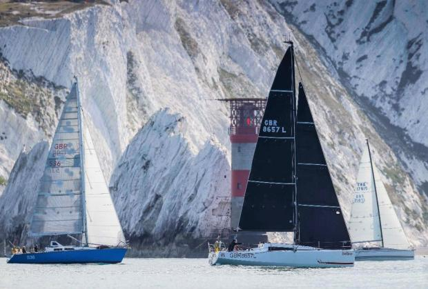 Isle of Wight County Press: Yachts pass the Needles as they race round the Isle of Wight.