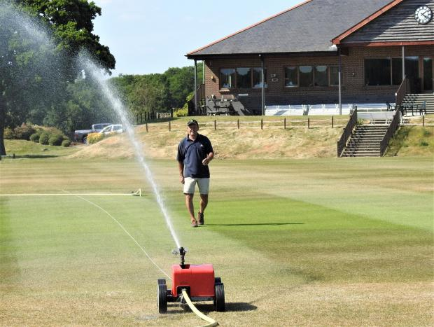 Isle of Wight County Press: Andy gives the Newclose square a good watering in the dry conditions during the coronavirus lockdown.