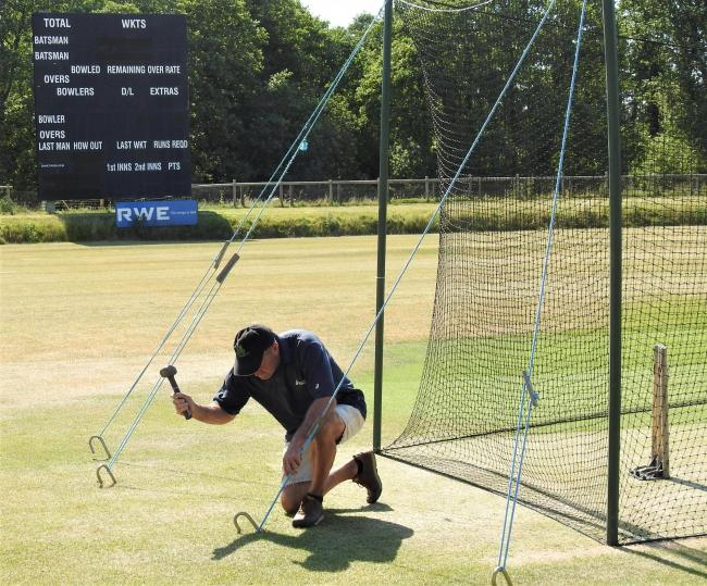 Andy Butler setting up practice nets on the Newclose square.