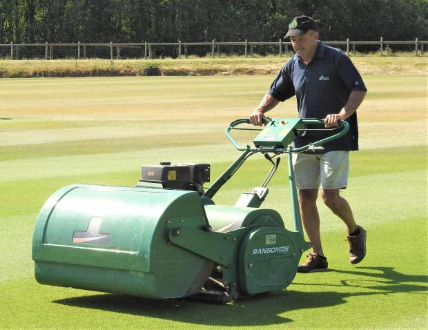 Isle of Wight County Press: Andy Butler giving the Newclose, the Isle of Wight's premier cricket ground, outfield a trim. Photo: Hugh Griffiths