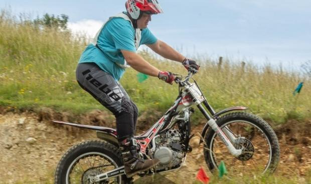 Isle of Wight County Press: Scott Milton in action in the first heat of the Isle of Wight Motorcycle Club Summer Trials Championships, at Newbarn Farm, Calbourne.