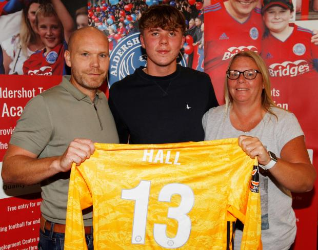 Isle of Wight County Press: Ryan with Aldershot boss Danny Searle and his mum.