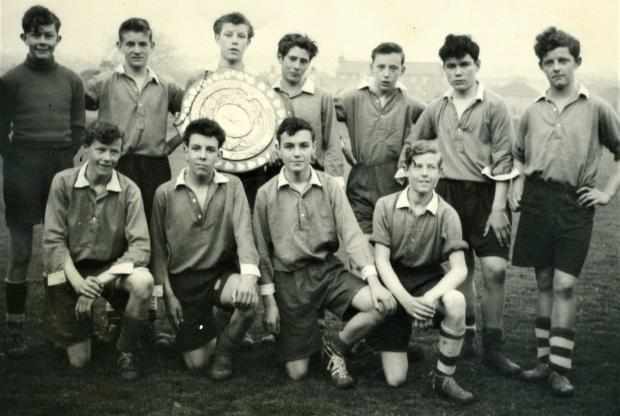 Isle of Wight County Press: The Barton Boys football team in Newport, which included in the front row, from left, singer Craig Douglas, Keith and local historian, Brian Greening.