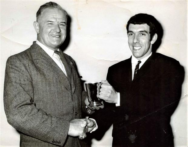 Isle of Wight County Press: Keith, right, receiving a special award for his 1,603 runs scored in a season.