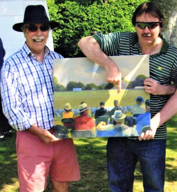 Isle of Wight County Press: Keith, left, with legendary ex-England wicketkeeper, turned artist, Jack Russell, pointing Keith out (in red shirt) in one of his paintings at a Sussex match.