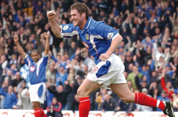 Isle of Wight County Press: Lee Bradbury celebrates a goal in Pompey's promotion winning season in the Championship in 2003.