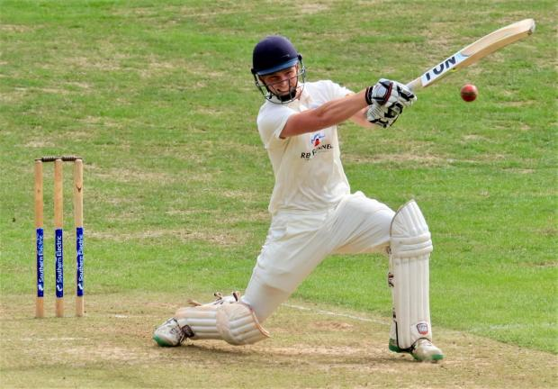 Isle of Wight County Press: Ventnor captain, Ross Whyte, in action against Newport. Photo: Dave Reynolds