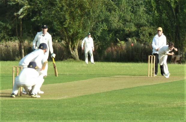 Isle of Wight County Press: Rollo Little, 13, making his adult cricket debut with the ball against Ventnor II, finishing with 1-10. Photo: Martin Little