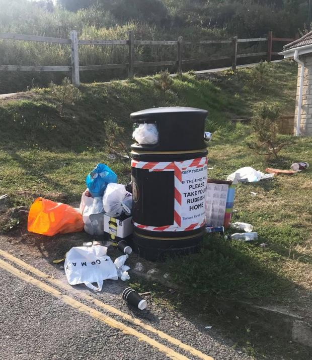 Isle of Wight County Press: Overflowing bins at Totland. Picture: Ian Gregory.