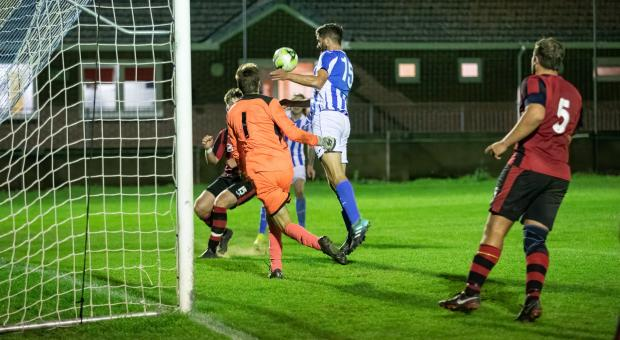 Isle of Wight County Press: Cowes striker Jared Wetherick misses a golden opportunity to score at the end of the tie.