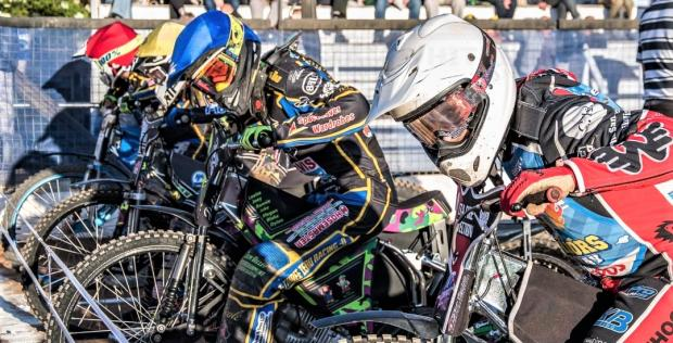 Isle of Wight County Press: Ben Morley (white helmet) and Chad Wirtzfeld (yellow helmet) at the starting gate getting ready for a race during Warriors 2019 visit to Plymouth in the National Trophy meeting last year. Photo: Ultimate Shot