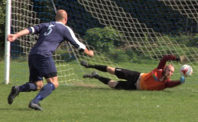 a great save by Ventnor keeper Matt Gifford, but the loose ball fell to Bembridge's Scott Sampson to finish.  Photos: Sandra Power