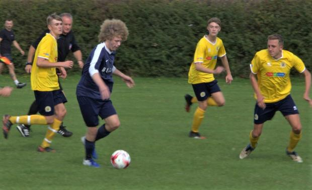 Isle of Wight County Press: Bembridge midfielder Ant Kettle (in blue) in action against Ventnor at Steyne Park.
