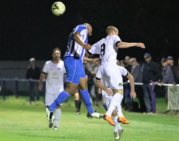 Isle of Wight County Press: Callum Chase (in blue) in FA Cup action against Weston-super-Mare in mid-week. Photo: Barbara Close