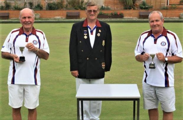 Isle of Wight County Press: Totland Bay Bowls Club — Trevor Philcox and David Collins receiving their trophies for winning the men's pairs final.