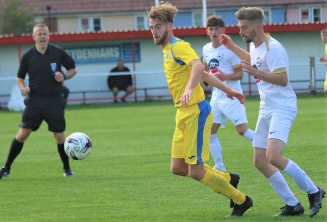 Joe Craig (in yellow) scored twice as Newport beat Fawley 3-0 at Beatrice Avenue on Tuesday.  Photo: Graham Brown