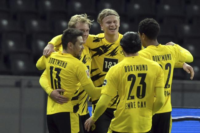 Erling Braut Haaland (centre) scored four goal as Borussia Dortmund thrashed Hertha Berlin