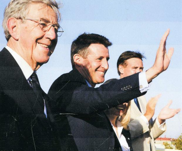 Isle of Wight County Press: David Ball with track legend Seb Coe on an open top bus on Ryde Esplanade.