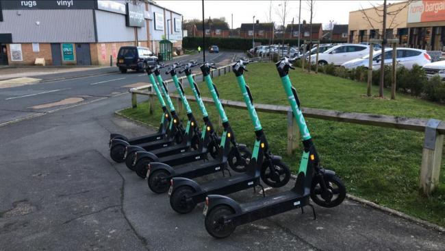 Beryl E-Scooters in a bay in Gunville, by Home Bargains.