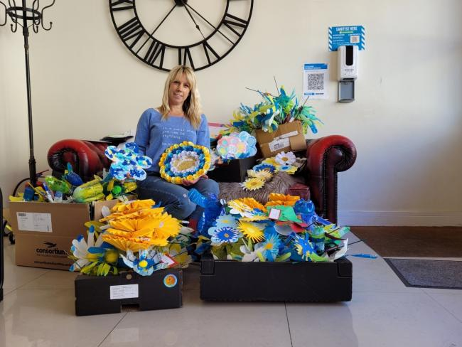 NBA's Fiona Brown surrounded by artwork from Newport primary schools