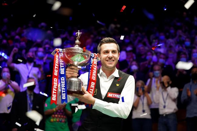 Mark Selby celebrates his victory over Shaun Murphy