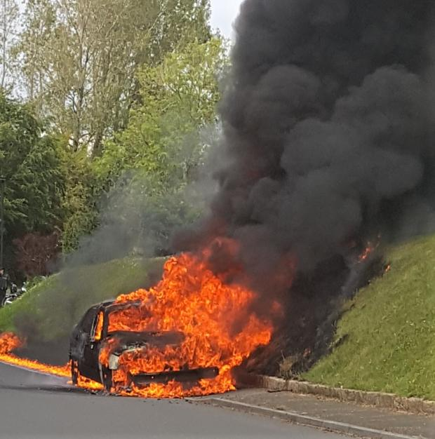 Isle of Wight County Press: The car was a fireball within minutes.  Photo: Jon Moreno