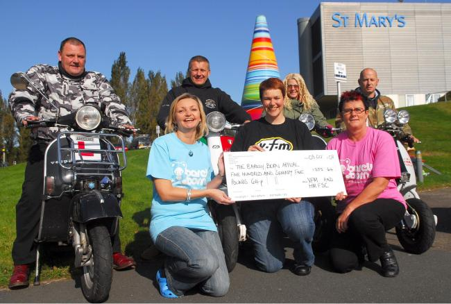Ten years ago: The Barely Born Appeal receives a £575 cheque from scooterists associated with the VFM and HMFSC, front, from left, Tarina Taylor (Barely Born), Tori Joy (VFM) and Cheryl Burtwell (Barely Born). Back, John Beecroft, Ian Birch, Kimberl